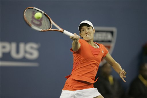 Justine Henin of Belgium returns a shot to Dinara Safina of Russia at the US Open tennis tournament in New York on Sunday.