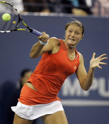 Dinara Safina of Russia returns a shot to Justine Henin of Belgium at the US Open tennis tournament in New York on Sunday.
