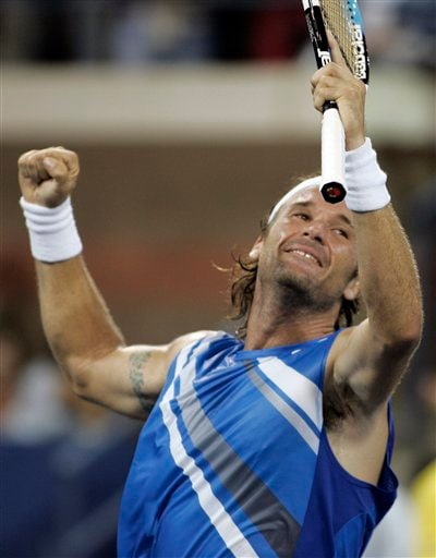 Carlos Moya of Spain celebrates his win over Philipp Kohlschreiber of Germany at the US Open tennis tournament in New York on Sunday.