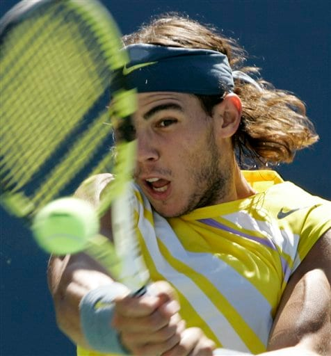 Rafael Nadal of Spain returns with a backhand to Jo-Wilfried Tsonga of France at the US Open tennis tournament in New York on Sunday.
