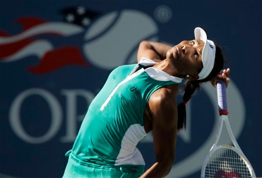 Venus Williams of the United States watches her ball as she serves to Ana Ivanovic of Serbia at the US Open tennis tournament in New York on Sunday.
