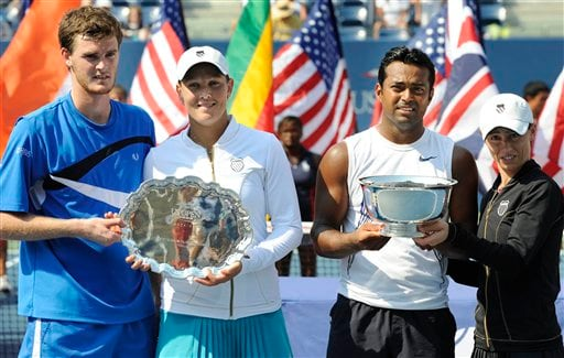 From left to right, Jamie Murray, Liezel Huber, Leander Paes, and Cara Black hold their trophies after the mixed doubles final match at the US Open in New York on Thursday, September 4, 2008. Paes and Black won the mixed doubles championship.