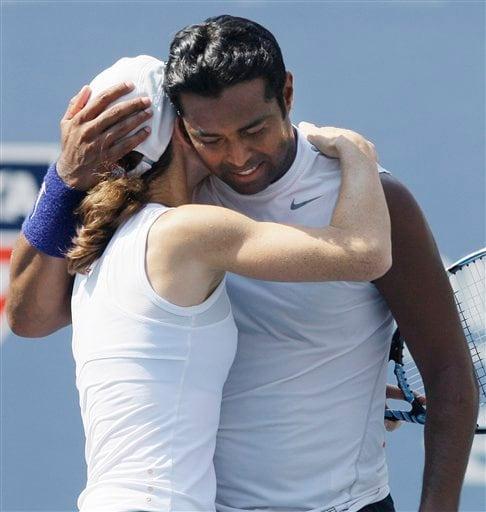 Cara Black, left, of Zimbabwe, and Leander Paes, of India, hug after their win over Liezel Huber, of the United States, and Jamie Murray, of Britain, at the mixed doubles final match during the US Open in New York on Thursday, September 4, 2008.