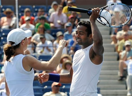 Cara Black, left, of Zimbabwe, and Leander Paes, of India, celebrate their win over Liezel Huber, of the United States, and Jamie Murray, of Britain, after the mixed doubles final match at the US Open in New York on Thursday, September 4, 2008.
