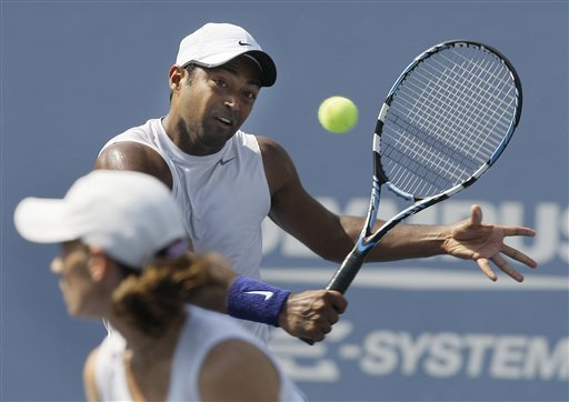 Cara Black, left, of Zimbabwe, and Leander Paes, of India, return to Liezel Huber, of the United States, and Jamie Murray, of Britain, during their mixed doubles final match at the US Open in New York on Thursday, September 4, 2008.