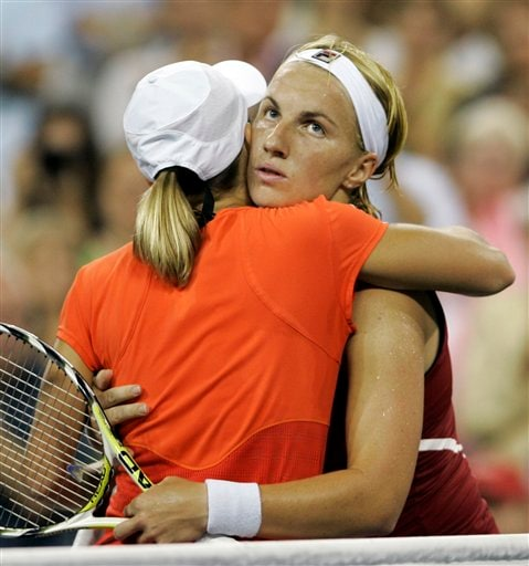 Svetlana Kuznetsova, right, of Russia is hugged by Justine Henin of Belgium after being defeated by Henin in the women's finals at the US Open tennis tournament in New York on Saturday.