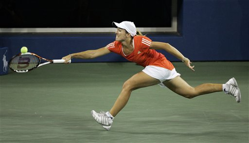 Justine Henin of Belgium races to return a volley to Svetlana Kuznetsova of Russia during the women's finals at the US Open tennis tournament in New York on Saturday.