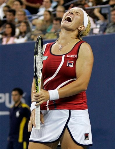 Svetlana Kuznetsova of Russia reacts after losing a point to Justine Henin of Belgium during the women's finals at the US Open tennis tournament in New York on Saturday.