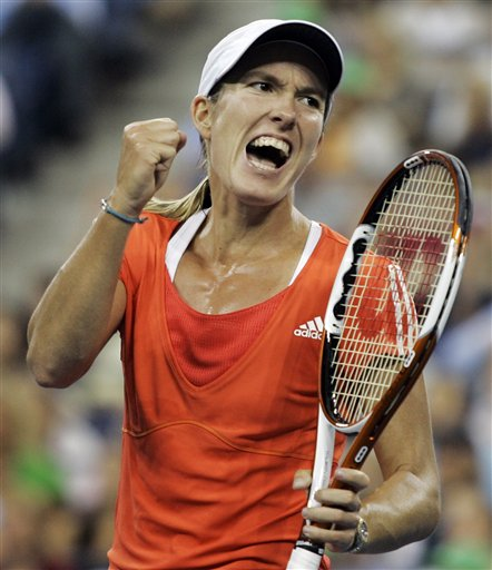 Justine Henin of Belgium reacts after winning a point against Svetlana Kuznetsova of Russia in the women's finals at the US Open tennis tournament in New York on Saturday.