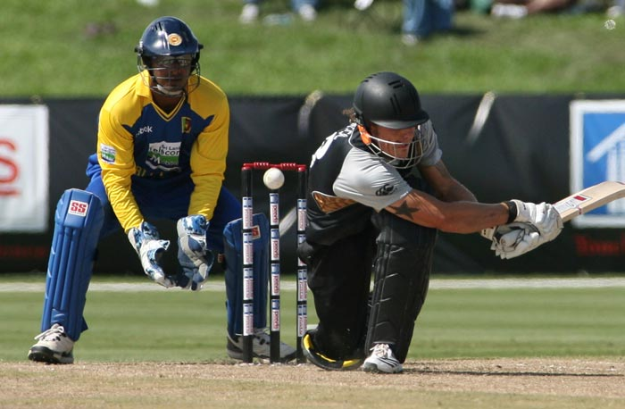 New Zealand's RJ Nicol misses a sweep as Sri Lanka's wicketkeeper Kumar Sangakkara looks on during the Pearls Cup T20 Series game being held at the Central Broward Regional Park in Fort Lauderdale. (AP Photo)