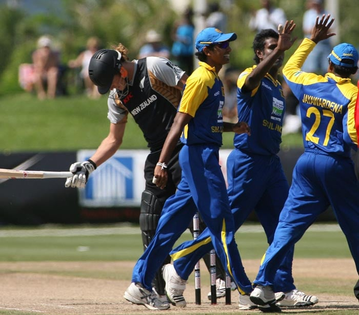 Sri Lankans celebrate a wicket as New Zealand's batsmen RJ Nicol reacts during the Pearls Cup T20 Series game being held at the Central Broward Regional Park in Fort Lauderdale. (AP Photo)
