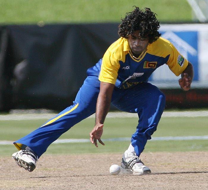 Sri Lankan bowler Lasith Malinga fields the ball against New Zealand during the Pearls Cup T20 Series game being held at the Central Broward Regional Park in Fort Lauderdale. (AP Photo)