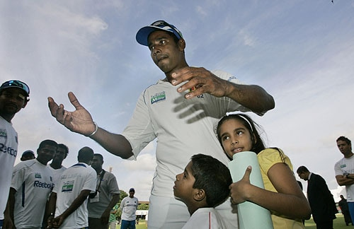 Chaminda Vaas's daughter Nethara hugs him at the end of play on the last day of the third Test between Sri Lanka and Pakistan in Colombo. (AP Photo)