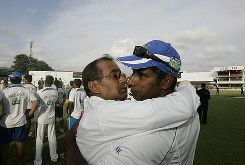 A Sri Lankan cricket fan hugs Chaminda Vaas at the end of play on the last day of the third Test between Sri Lanka and Pakistan in Colombo. (AP Photo)