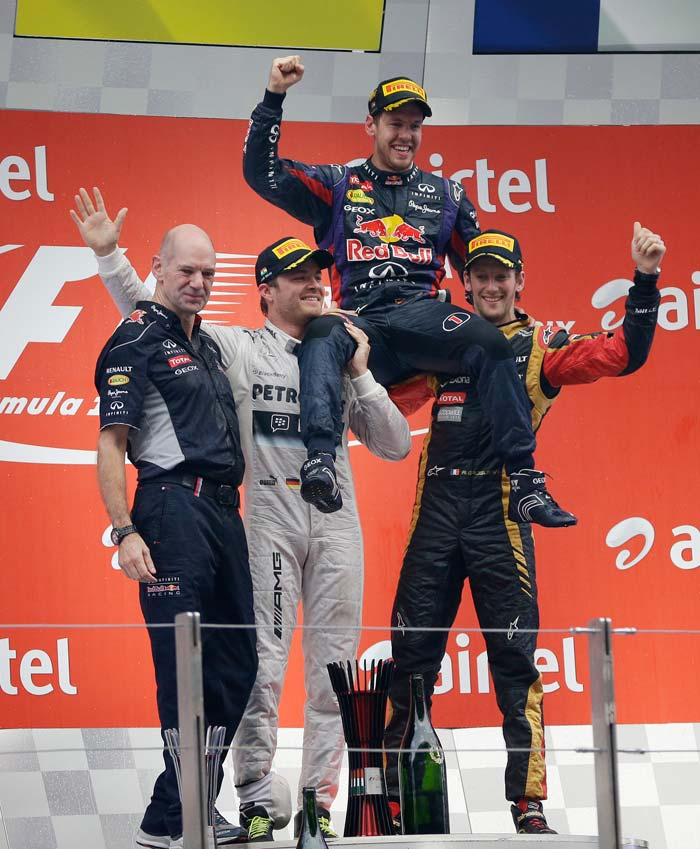 Pole-sitter Vettel pitted early to change his soft tyres but then sped through the field to win 30 seconds ahead of Mercedes's Nico Rosberg, with Lotus driver Romain Grosjean third.