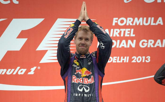 Red Bull and Sebastian Vettel realised their dreams at the Indian Grand Prix. The German won the race comprehensively to seal his fourth drivers' championship title. His team also sealed the top team spot. <br><br> Images courtesy AFP and AP