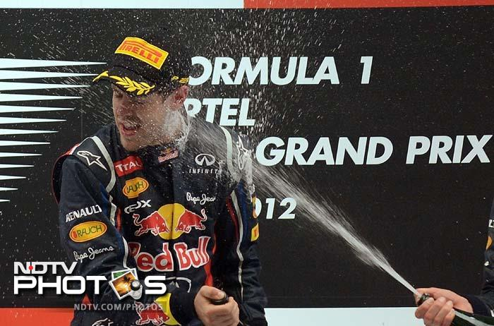 Sebastian Vettel gave the phrase 'showering with joy' a whole new meaning after winning the Indian Grand Prix.