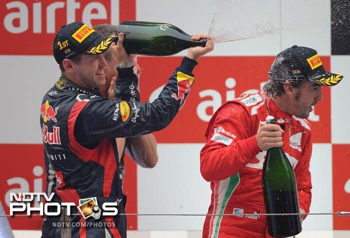 Vettel's joy knew no bounds as he is seen here letting out the champagne on second placed Fernando Alonso in the exuberance of youth.