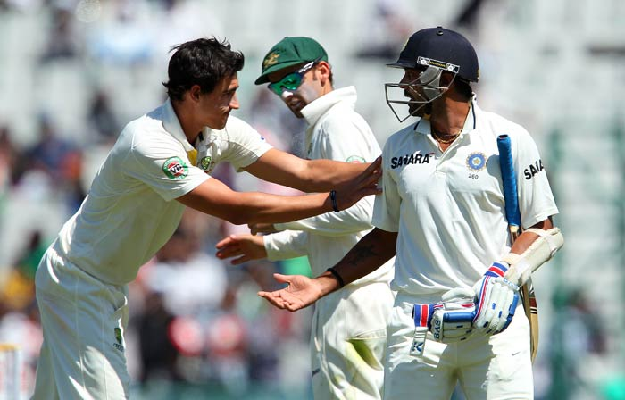 Mitchell Starc (left) eventually got the better of Vijay as the batsman fell after adding just three to his 150. (Image courtesy: BCCI)