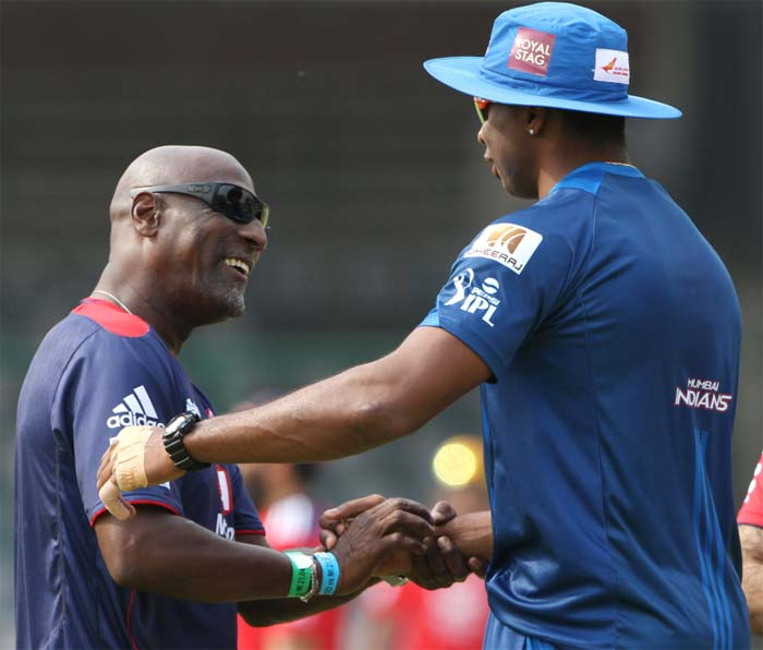 West Indies' Kieron Pollard is seen here wishing Viv before the start of his team's match against Delhi. (BCCI image)