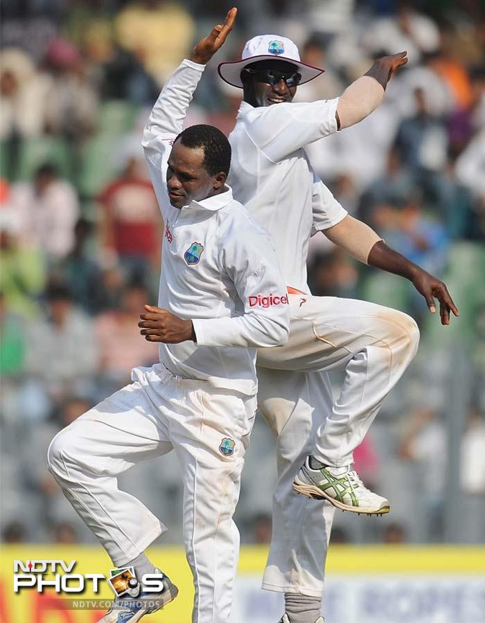 It was Marlon Samuels who brought an end to the stand when he got the better of Dravid and found the stumps with his slow spin.