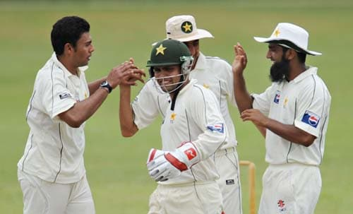 Danish Kaneria celebrates with teammates Kamran Akmal, Younus Khan and Mohammad Yousuf after the dismissal of Upul Tharanga during the first day of a three-day practice match between Pakistan and Sri Lanka Board XI in Colombo. (AFP Photo)