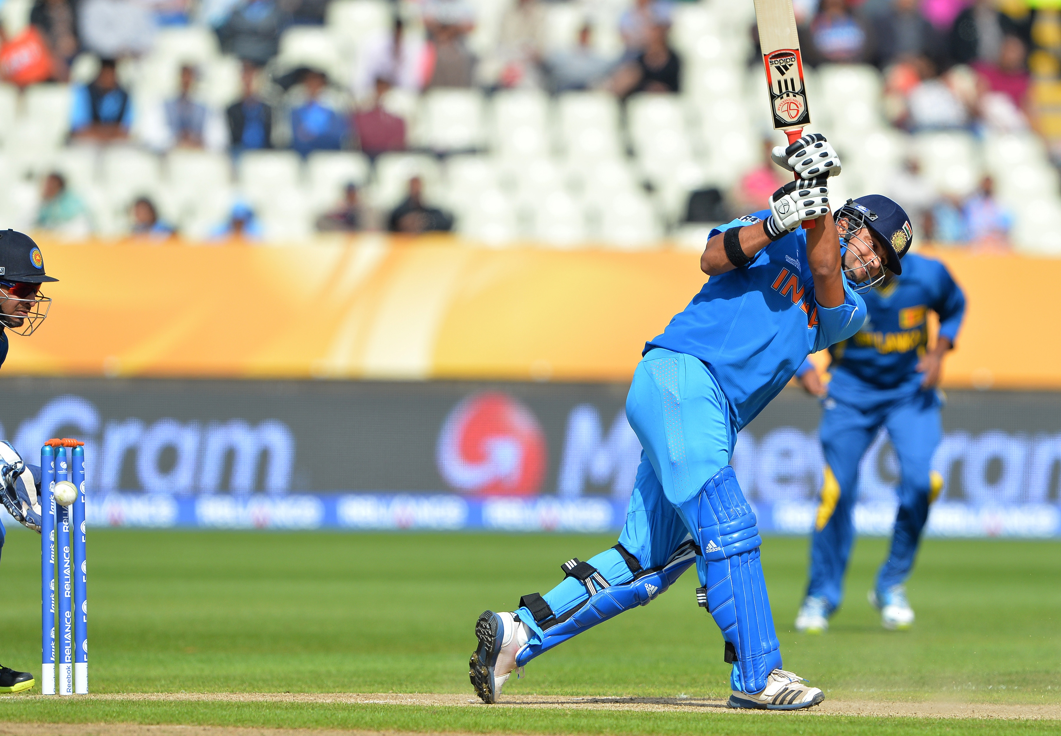 Suresh Raina brought momentum to the Indian run chase as he contributed 34 runs in a 48-run stand with Virat Kohli against Sri Lanka at Edgbaston, Birmingham. Raina's 31-ball knock contained four hits to the fence.