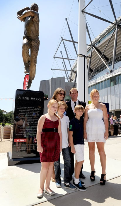 A trimmer Shane Warne saw himself immortalised in 300kg of bronze with the unveiling of a rather hefty statue of him outside the Melbourne Cricket Ground in a ceremony also attended by his British model girlfriend Elizabeth Hurley.