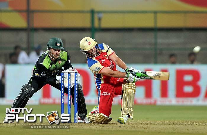 AB de Villers lofts a shot against Warriors as he went on to score 31 runs for Royal Challengers Bangalore.