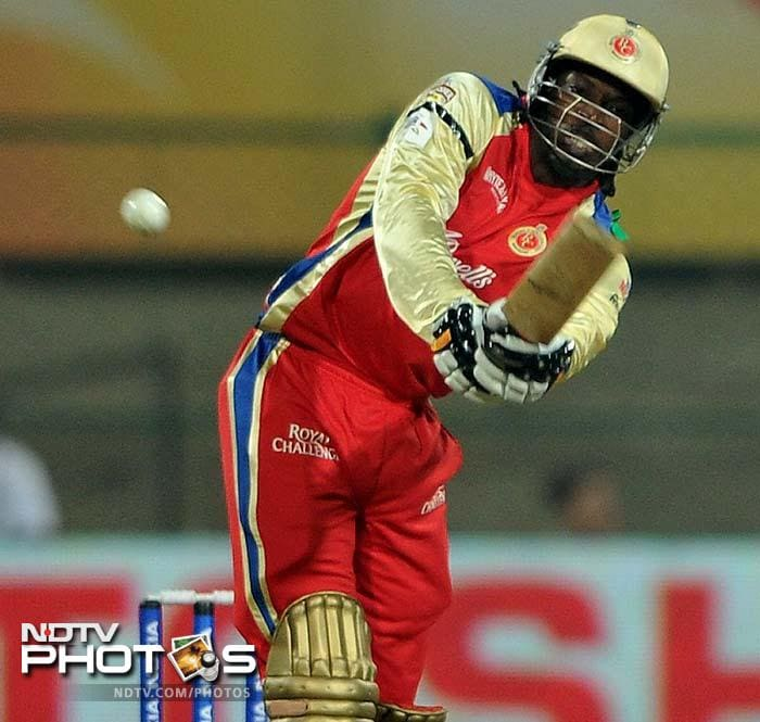 Chris Gayle plays a shot during the match which also marked his debut in CLT20.