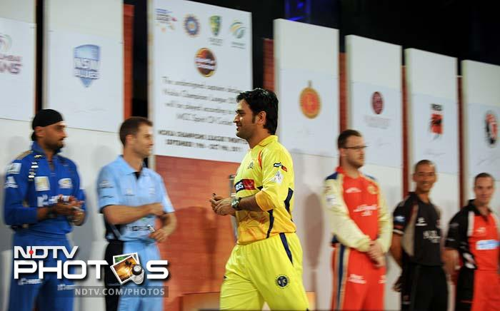 Skipper of the defending champions - MS Dhoni (in yellow) - walks up to the stage for his team, the Chennai Super Kings.
