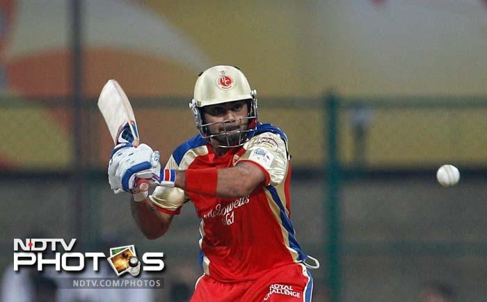 Virat Kohli at his cautious best as he plays a shot against the Warriors.