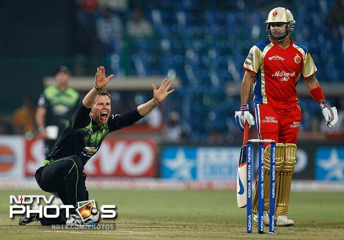 Johan Botha (l) appeals as Virat Kohli watches on during the match between the Warriors and the Royal Challengers Bangalore.