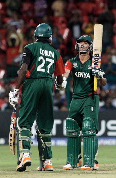 Collins Obuya congratulates Tammay Mishra on reaching 50 batting in the 2011 ICC World Cup Group A match between Australia and Kenya at M. Chinnaswamy Stadium in Bangalore. (Getty Images)