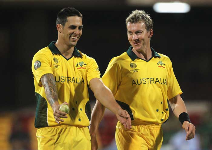 Mitchell Johnson and Brett Lee share a joke during the 2011 ICC World Cup Group A match between Australia and Kenya at M. Chinnaswamy Stadium in Bangalore. (Getty Images)