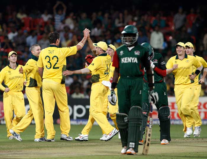 Shaun Tait is congratulated after Alex Obanda is clean bowled in the 2011 ICC World Cup Group A match between Australia and Kenya at M. Chinnaswamy Stadium in Bangalore. (Getty Images)