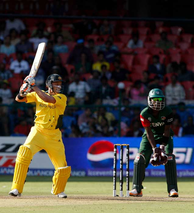 Michael Hussey batting watched by wicketkeeper Morris Ouma in the 2011 ICC World Cup Group A match between Australia and Kenya at M. Chinnaswamy Stadium in Bangalore. (Getty Images)