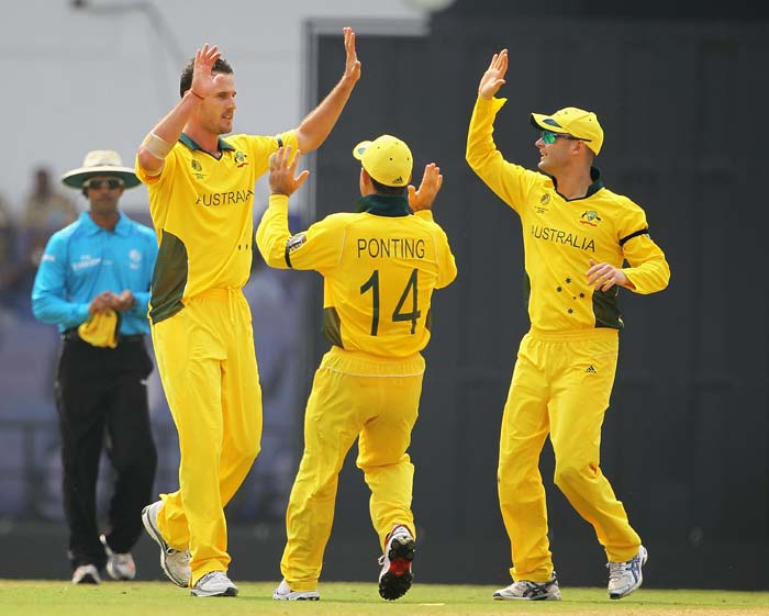 Ricky Ponting and Michael Clarke congratulate Shaun Tait, after he bowled Ross Taylor during the 2011 ICC World Cup Group A match between Australia and New Zealand at Vidarbha Cricket Association Ground in Nagpur. (Getty Images)