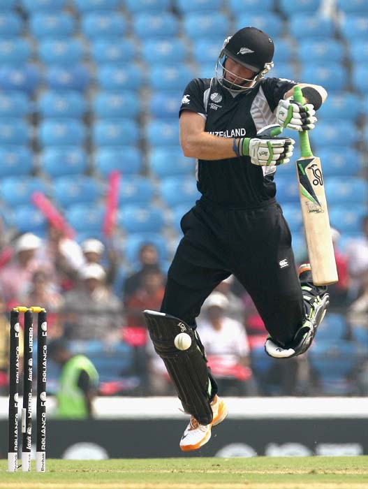 Martin Guptill fends off a short ball from Brett Lee during the 2011 ICC World Cup Group A match between Australia and New Zealand at Vidarbha Cricket Association Ground in Nagpur. (Getty Images)
