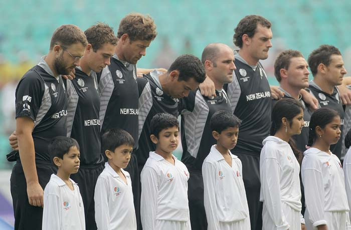 The New Zealand team observe a minute's silence in memory of the victims of the Christchurch Earthquake ahead of the 2011 ICC World Cup Group A match between Australia and New Zealand at Vidarbha Cricket Association Ground in Nagpur. (Getty Images)