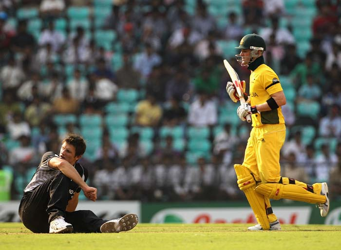 Hamish Bennett goes to ground as Michael Clarke takes a run during the 2011 ICC World Cup Group A match between Australia and New Zealand at Vidarbha Cricket Association Ground in Nagpur. (Getty Images)