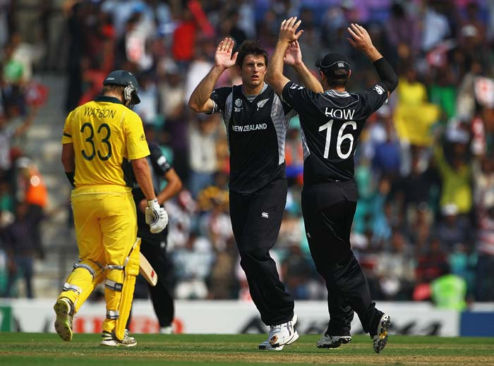 Martin Bennett is congratulated by Jamie How, after he bowled Shane Watson during the 2011 ICC World Cup Group A match between Australia and New Zealand at Vidarbha Cricket Association Ground in Nagpur. (Getty Images)