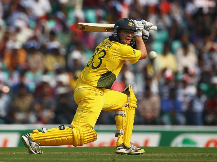 Shane Watson hits the ball towards the boundary during the 2011 ICC World Cup Group A match between Australia and New Zealand at Vidarbha Cricket Association Ground in Nagpur. (Getty Images)
