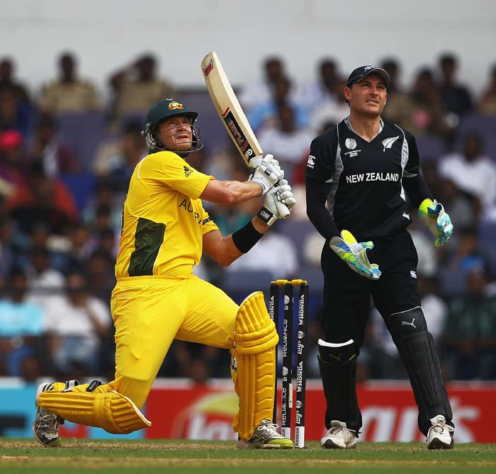 Shane Watson hits a six, as Brendon McCullum looks on during the 2011 ICC World Cup Group A match between Australia and New Zealand at Vidarbha Cricket Association Ground in Nagpur. (Getty Images)