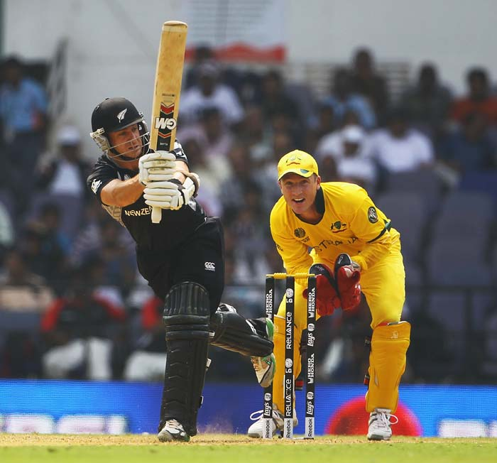 Brendon McCullum hits the ball towards the boundary, as Brad Haddin looks on during the 2011 ICC World Cup Group A match between Australia and New Zealand at Vidarbha Cricket Association Ground in Nagpur. (Getty Images)
