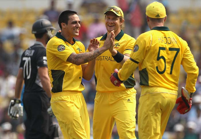 Mitchell Johnson celebrates with teammates Shane Watson and Brad Haddin after taking the wicket of James Franklin during the 2011 ICC World Cup Group A match between Australia and New Zealand at Vidarbha Cricket Association Ground in Nagpur. (Getty Images)