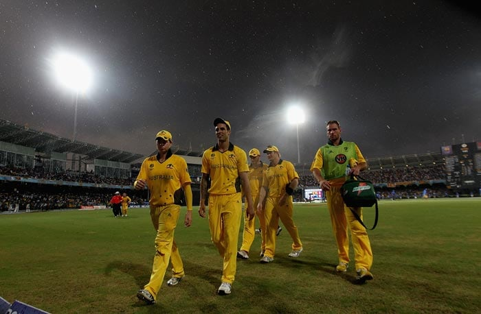 The Australian team leaves the field as rain halts play during the 2011 ICC World Cup Group A match between Australia and Sri Lanka at R. Premadasa Stadium in Colombo. (Getty Images)
