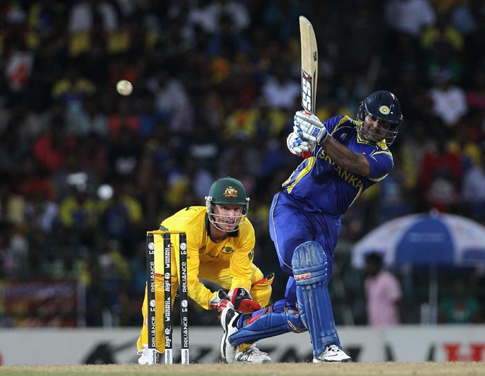 Kumar Sangakkara hits over midwicket with Brad Haddin looking on during the 2011 ICC World Cup Group A match between Australia and Sri Lanka at R. Premadasa Stadium in Colombo, Sri Lanka. After winning the toss and choosing to bat first Sri Lanka were 146-3 off 32.5 overs as rain stops play. (Getty Images)