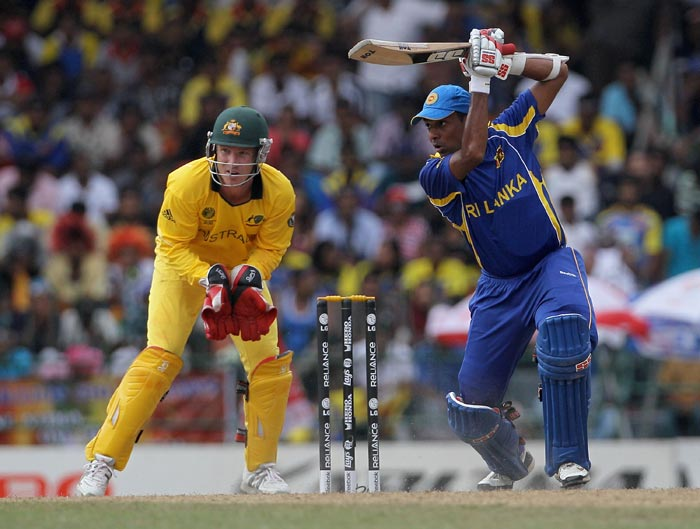 Thilan Samaraweera cuts with Brad Haddin looking on during the 2011 ICC World Cup Group A match between Australia and Sri Lanka at R. Premadasa Stadium in Colombo. (Getty Images)