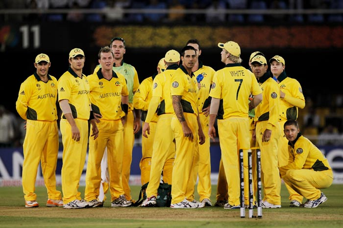 Australian players watch the replay of a successful referral during 2011 ICC World Cup Group A match against Zimbabwe at the Sardar Patel Stadium in Ahmedabad. (Getty Images)
